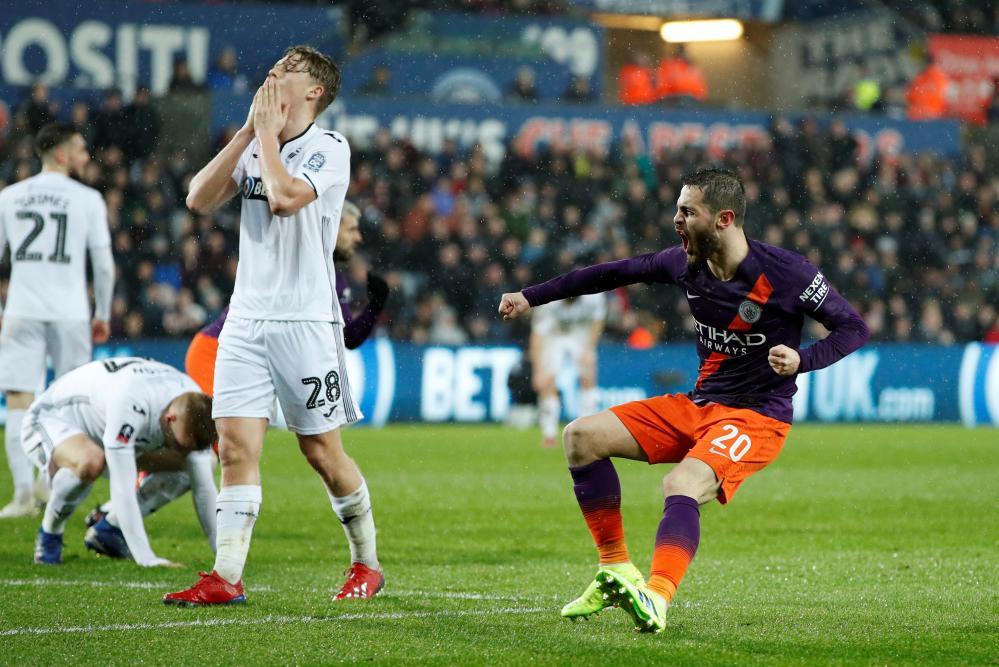 Manchester City's Bernardo Silva celebrates scoring their first goal .