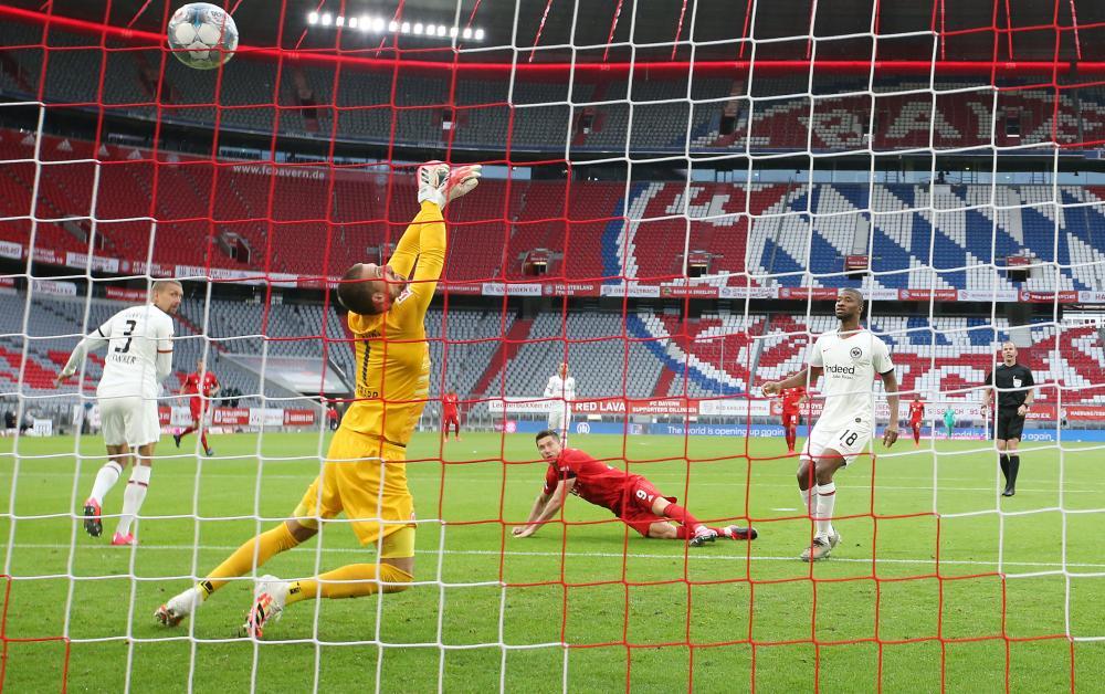Robert Lewandowski heads home Bayern Munich's third.