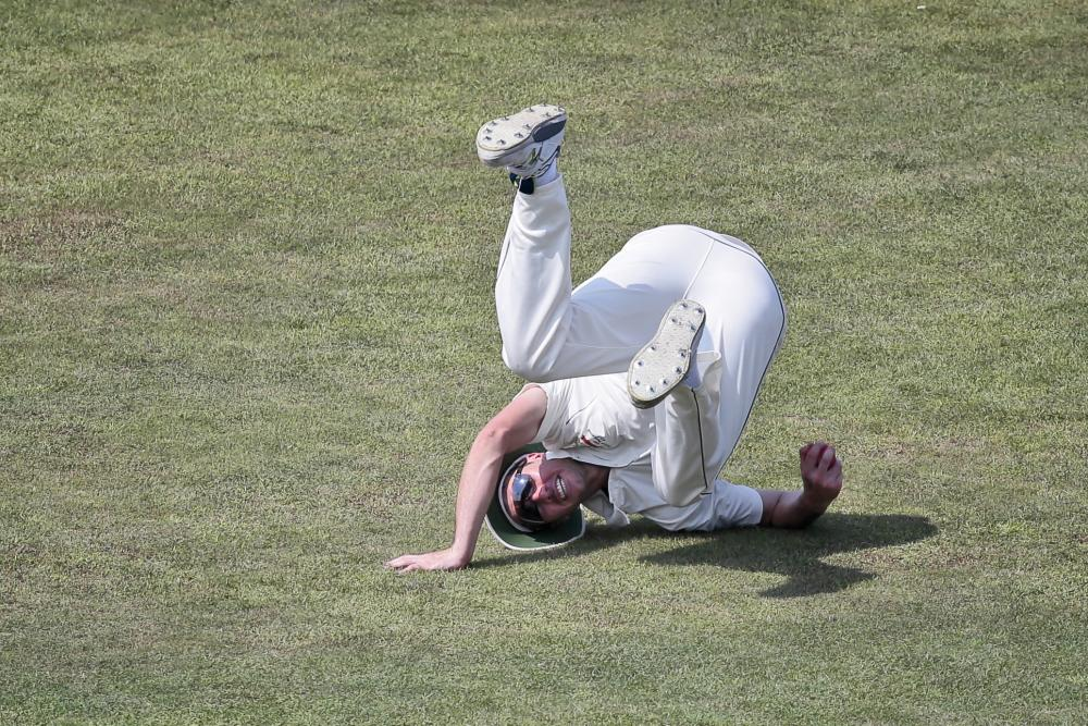 Steve O'Keefe taking the time to perfect his B-boy turtle spin on the Chittagong outfield.