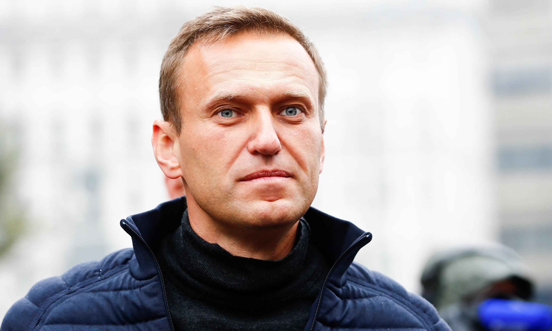 Russian opposition leader Alexei Navalny condemns mass raids