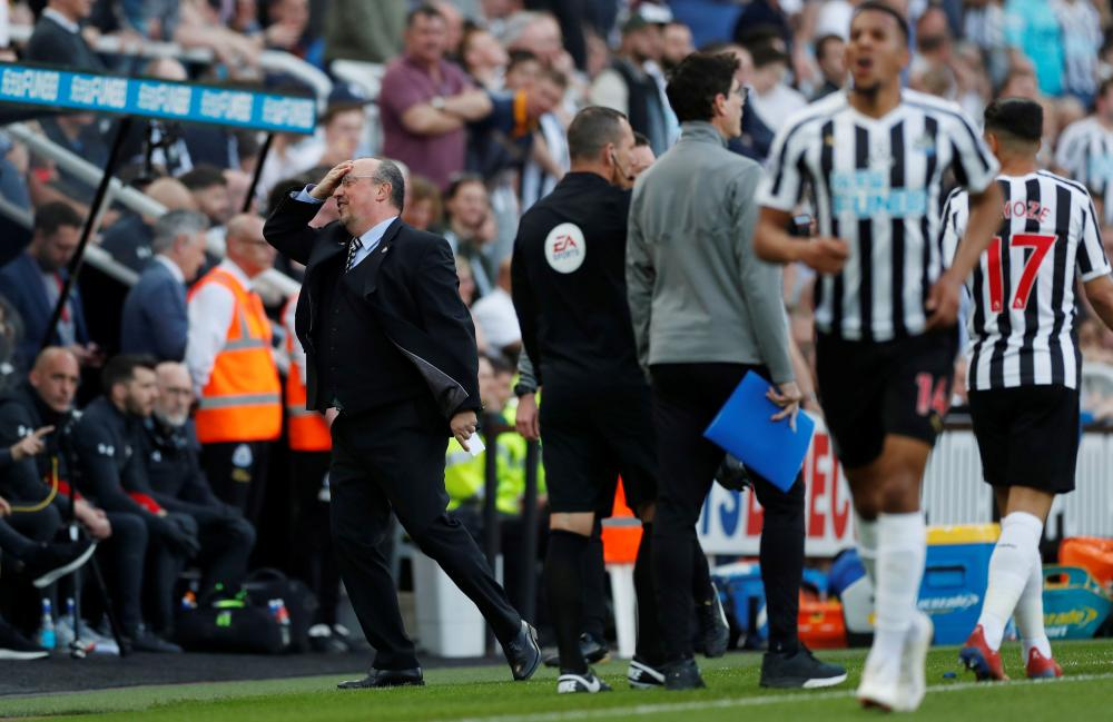 Newcastle United manager Rafael Benitez can't believe it's only a yellow card.