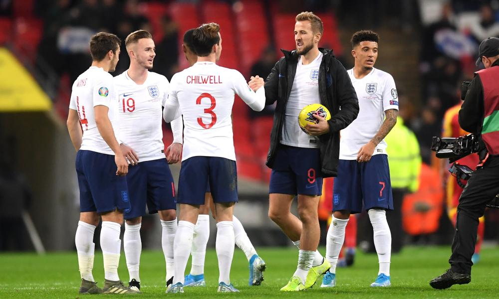Harry Kane of England celebrates with Ben Chilwell as he claims the match ball.