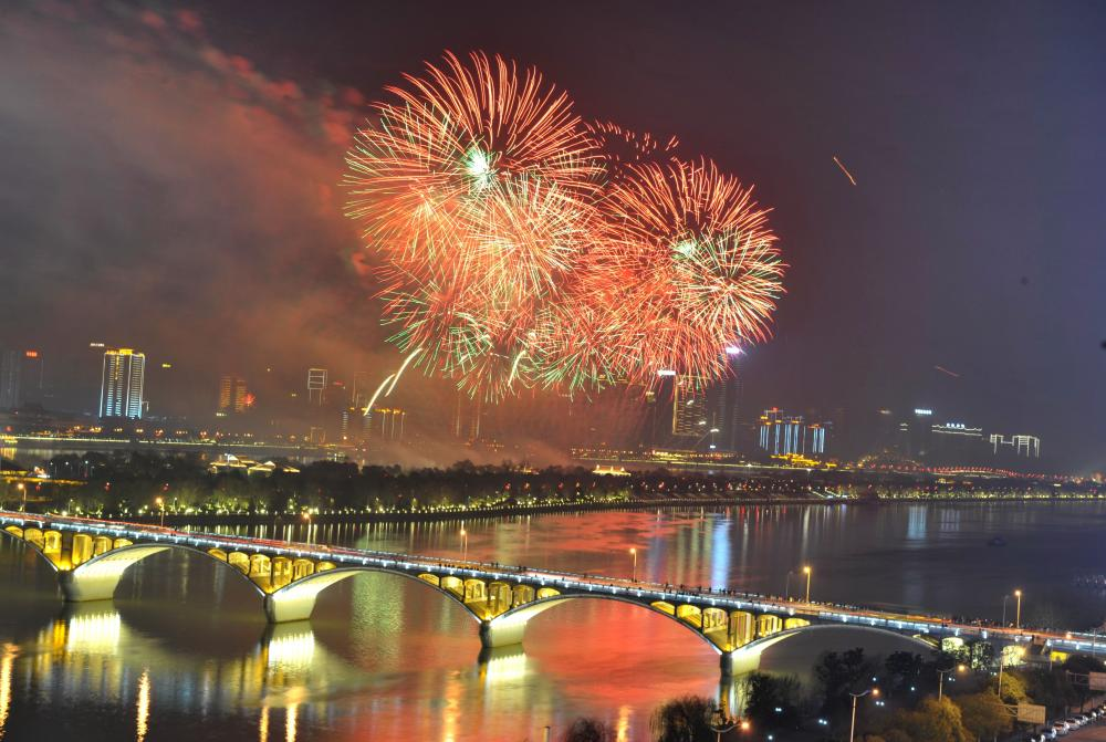 Chinese New Year Celebrations, Changsha - 08 Feb 2016Mandatory Credit: Photo by Xinhua/REX/Shutterstock (5583329a) Fireworks paint the sky over the Juzizhou Bridge in Changsha, capital of central China's Hunan Province, Feb. 7, 2016. A musical firework show was held in Changsha on Sunday night marking the Chinese Lunar New Year. Chinese New Year Celebrations, Changsha - 08 Feb 2016