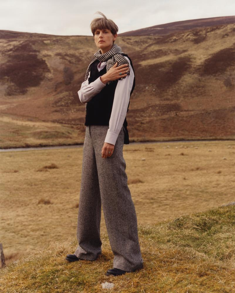Stella Tennant models wide legged tweed trousers for Holland & Holland AW16/17.
