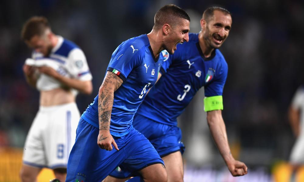 Marco Verratti of Italy (left) celebrates with Giorgio Chiellini after scoring.