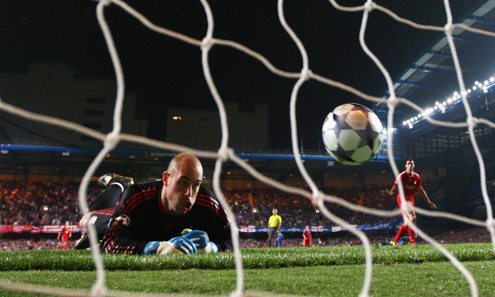 Liverpool's Pepe Reina looks back in despair as he concedes another goal against Chelsea in 2009.