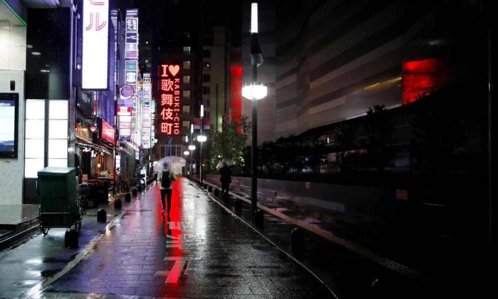 Almost empty street is seen after the government announced the state of emergency following the coronavirus disease outbreak at Kabukicho district in Tokyo.