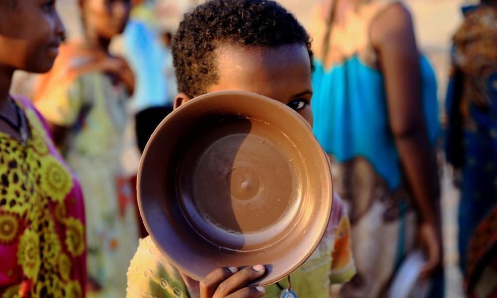 An Ethiopian child queues for food at the Um Rakuba camp, on the Sudan-Ethiopia border in Al-Qadarif state, Sudan