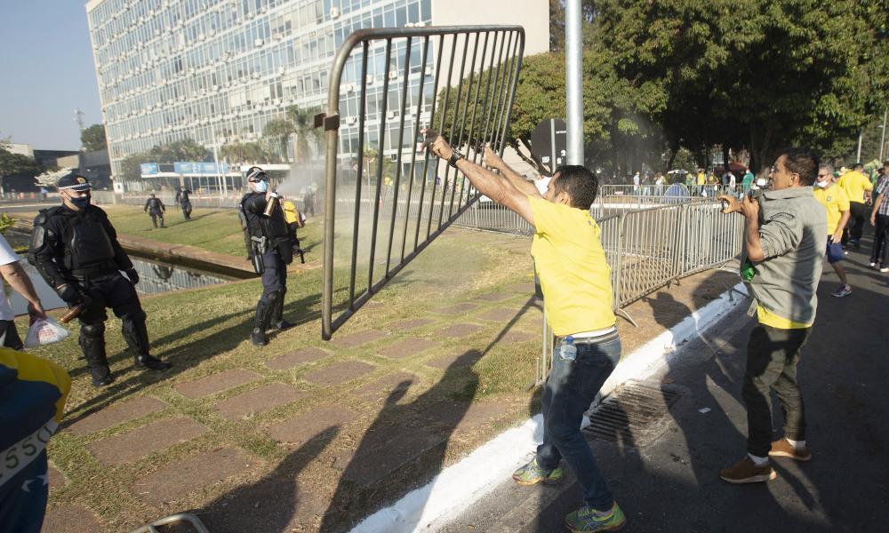 Supporters of Jair Bolsonaro clash with police.