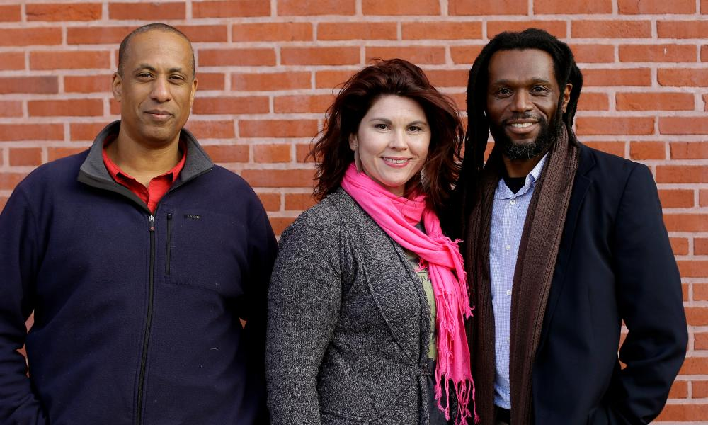Jonathan Herbert, left, with his friends Marlin Barber and his wife, Jaime