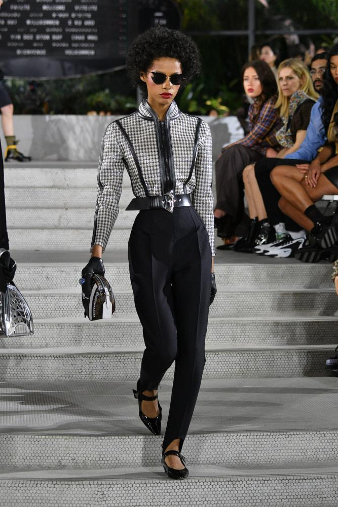 A model walks the catwalk for Louis Vuitton.