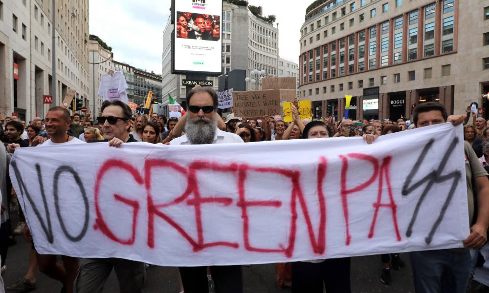 Demonstrators rally during a protest against the 'Green Pass' vaccine passport in the centre of Milan.