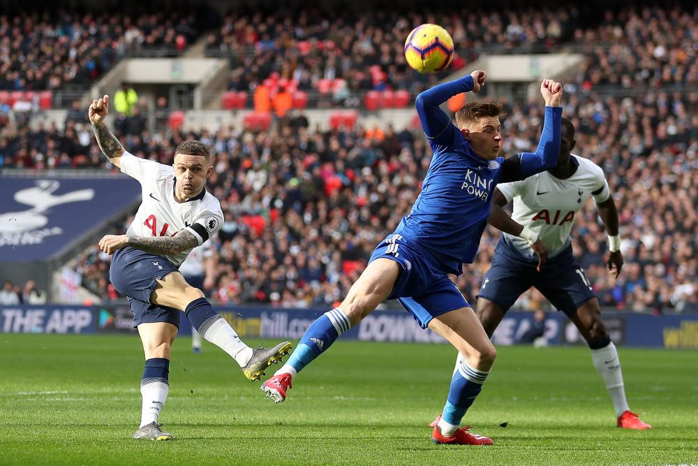 Trippier shoots, but is deflected wide.