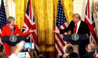 FILE PHOTO - British Prime Minister Theresa May and U.S. President Donald Trump gesture towards each other during their joint news conference at the White House in Washington, U.S., January 27, 2017.   REUTERS/Kevin Lamarque/Files