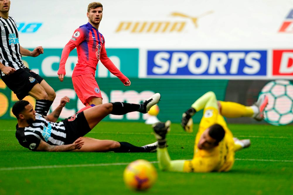 Chelsea's Timo Werner watches as his shot is saved by Newcastle keeper Karl Darlow.