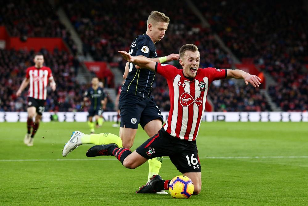 James Ward-Prowse of Southampton goes to ground in the box under pressure from Oleksandr Zinchenko.