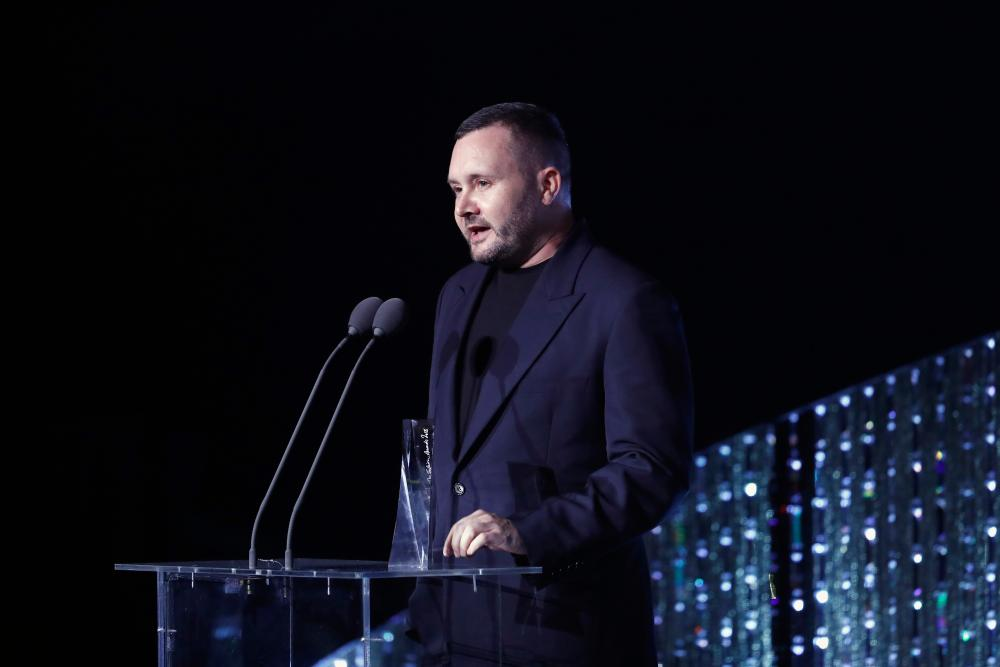 Kim Jones speaks on stage during The Fashion Awards