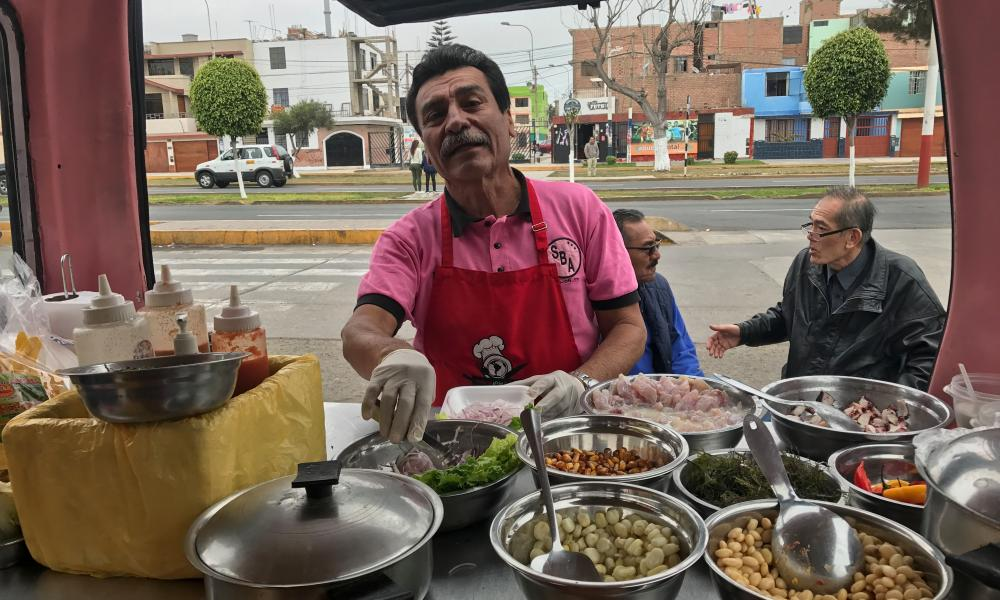 Freddy Alarcón offering a few tips on how to make a great ceviche at the back of his food truck La Combi Roja in Callao, Peru.