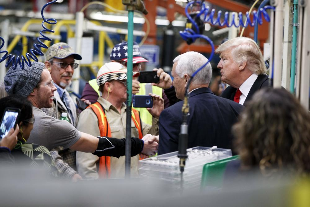 Trump and Pence talk with factory workers. New analysis shows the Trump administration has systematically attacked workers' rights.
