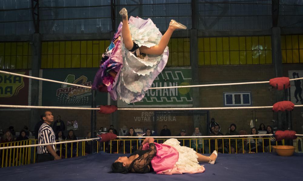 Two women fight in the ring wrestling in El Alto
