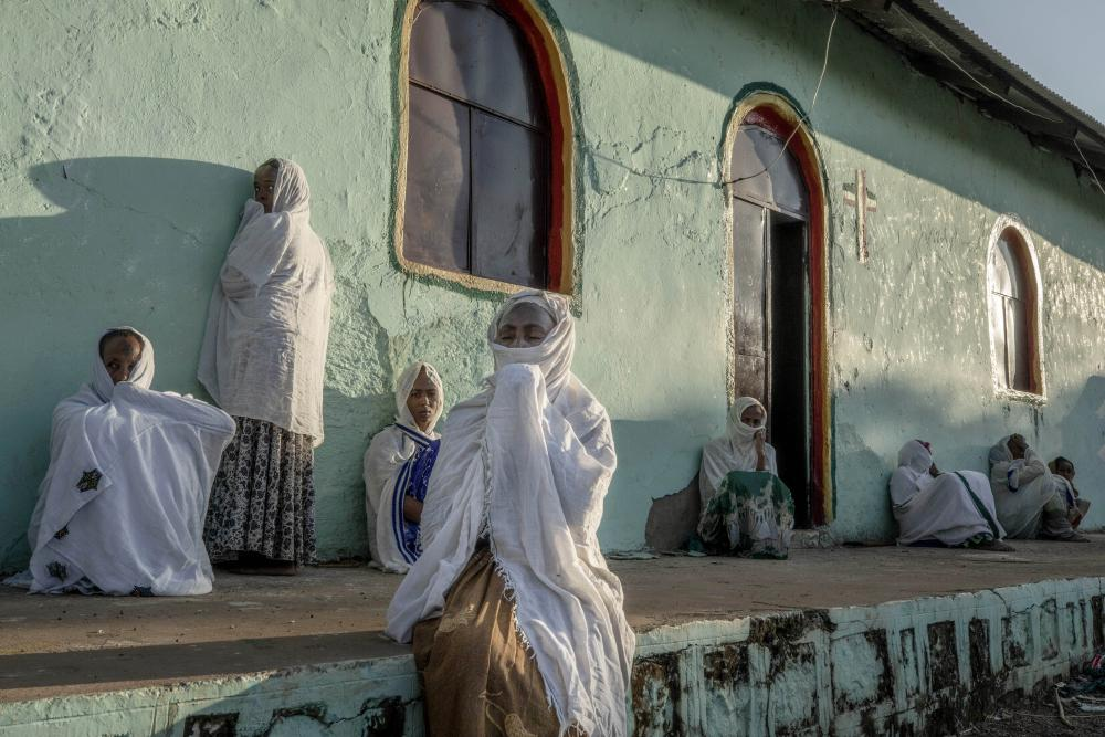 Women who fled the conflict in Ethiopia's Tigray region pray at a church near Umm Rakouba refugee camp in Qadarif, eastern Sudan, last November.