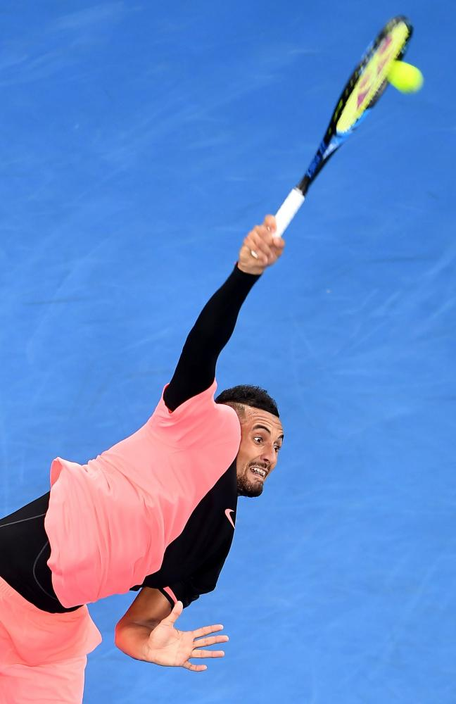 Nick Kyrgios serves against Rogerio Dutra Silva.