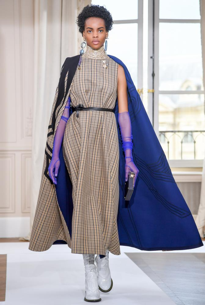 Cape and sheer gloves at Schiaparelli