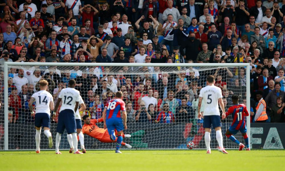 Crystal Palace's Wilfried Zaha scores their first goal from the penalty spot.