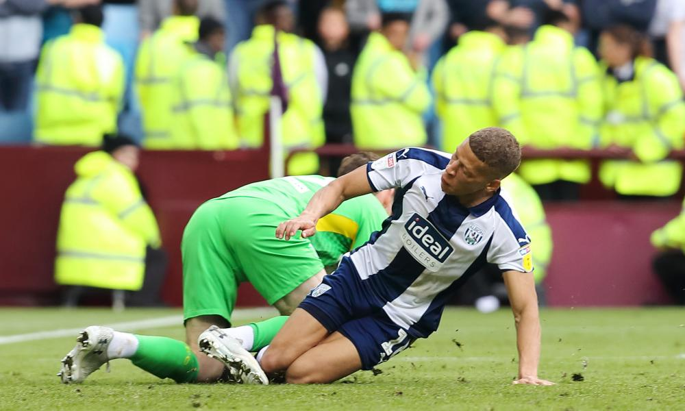 Dwight Gayle of West Bromwich Albion challenges goalkeeper Jed Steer of Aston Villa which resulted in him receiving a red card.
