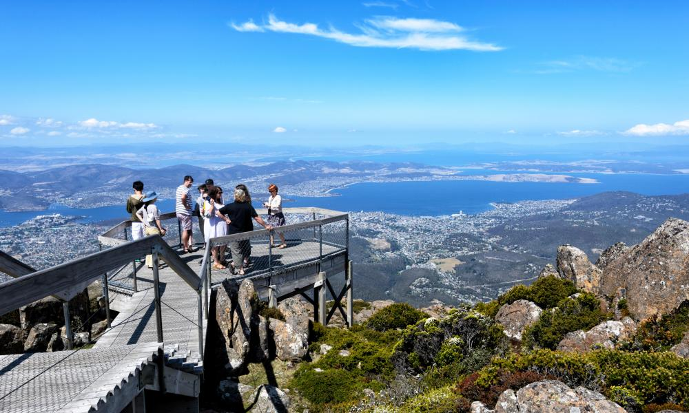 Sightseers take in the view of Hobart from the lookout on top of Mount Wellington