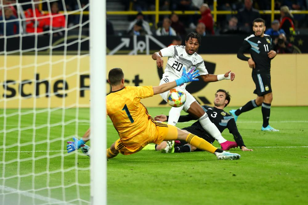 Serge Gnabry of Germany scores his team's first goal.