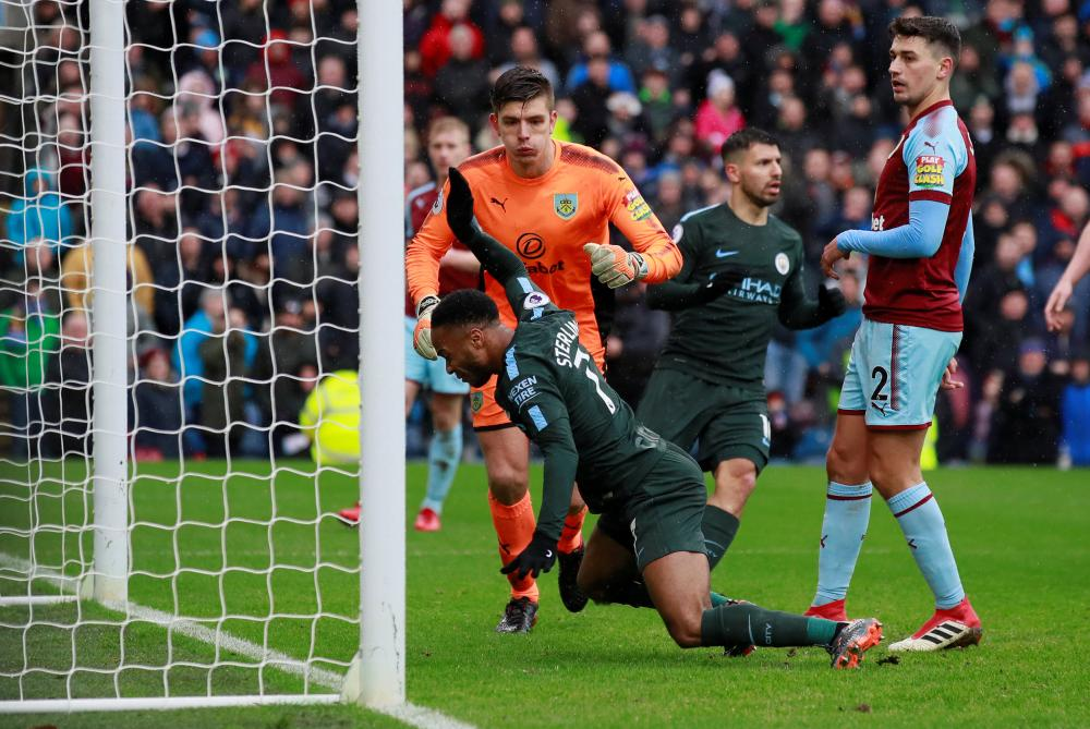 Sterling hits the ground in frustration.