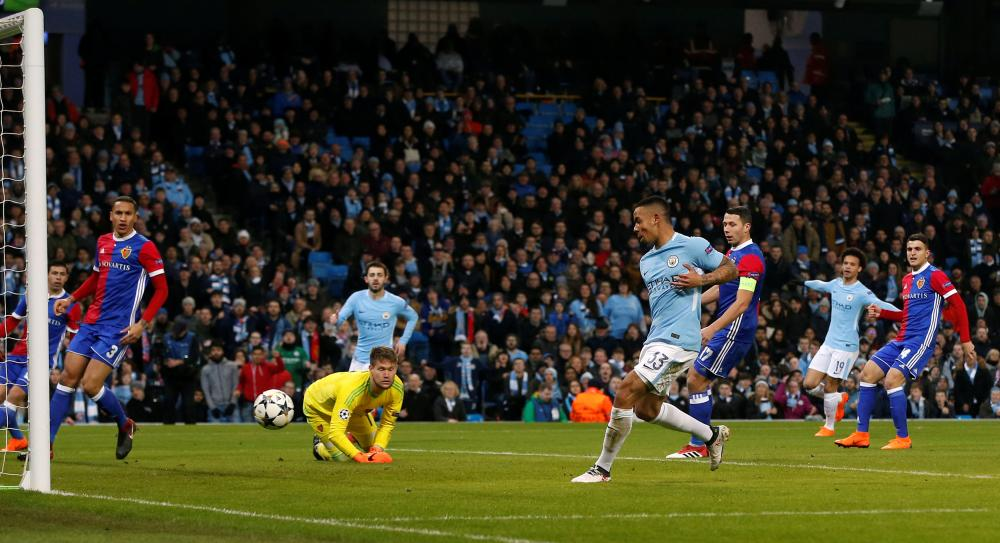 Manchester City's Gabriel Jesus scores their first goal.