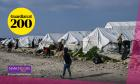 A child walks past tents inside the new refugee camp of Kara Tepe in Mytilini on March 29, 2021