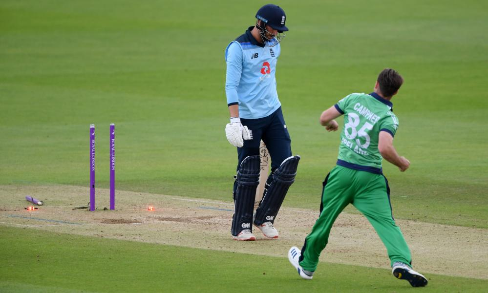 Ireland's Curtis Campher (right) celebrates bowling England's James Vince, who trudges off the pitch.