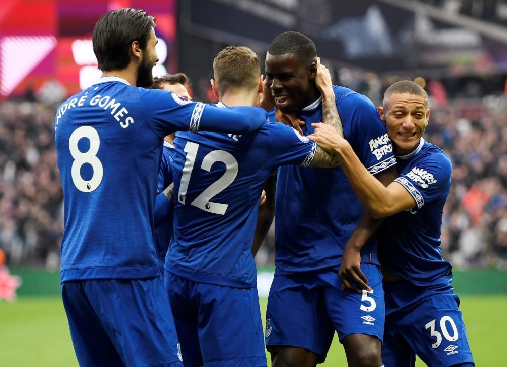 Everton's Kurt Zouma celebrates scoring their first goal with teammates