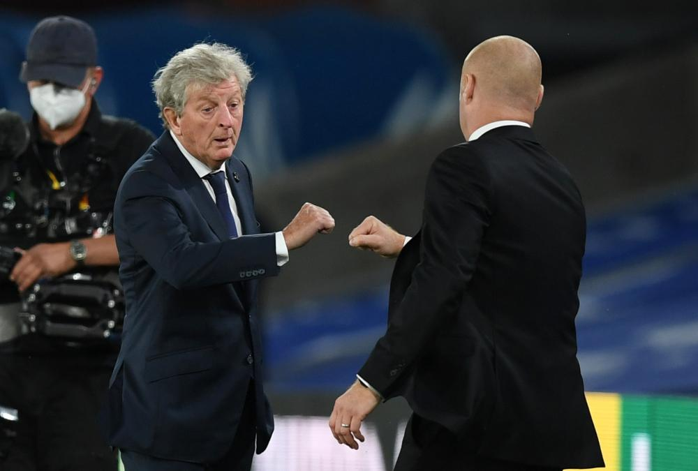 Roy Hodgson touches fists with Sean Dyche at full time.