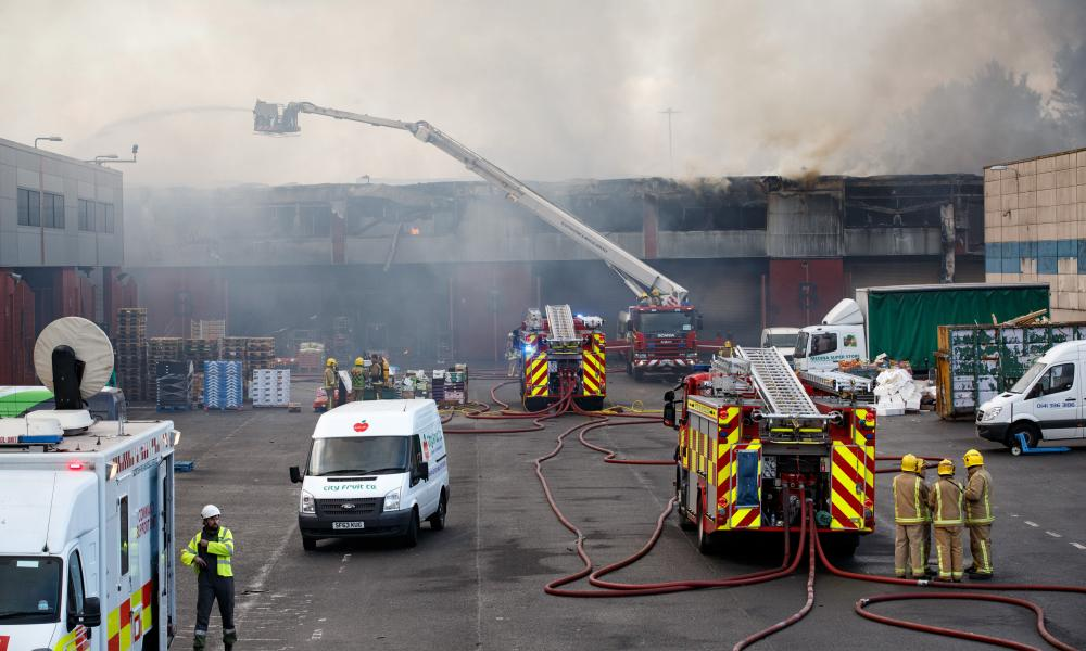 Firefighters work at the scene.