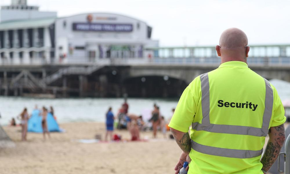 A security guard looks over Bournemouth beach.