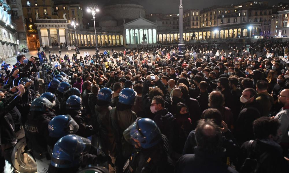Police stand guard as hundreds of people gathered in Naples to protest against coronavirus measures.