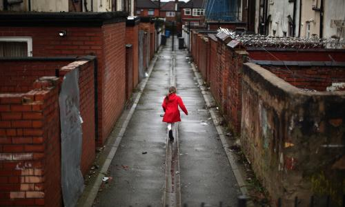 DO NOT USE - THIS IMAGE HAS BEEN OVER USED AND IS IN DANGER OF BECOMING A CLICHE A young girl spends the half term school holiday playing in an an alleyway.