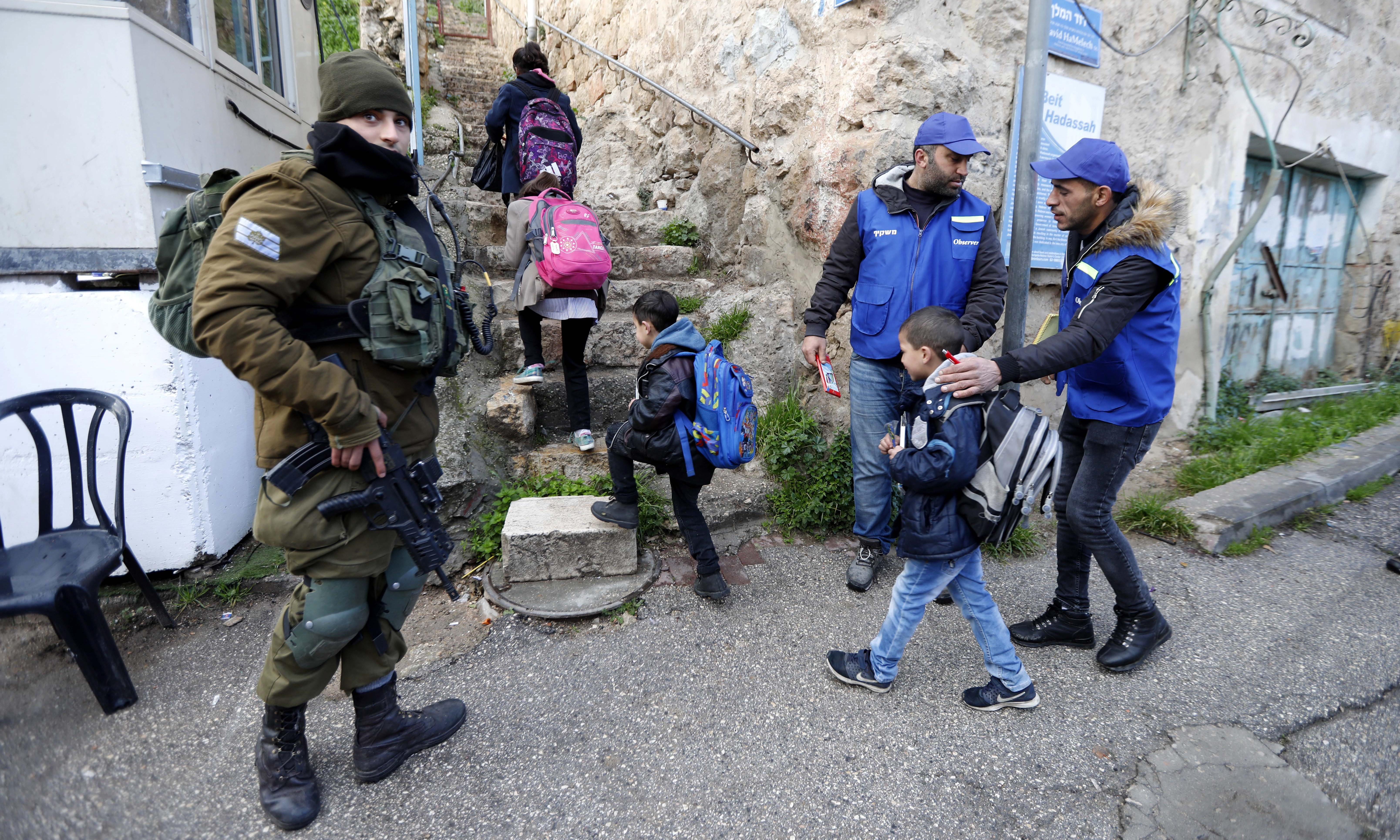 Palestinians patrol Hebron after Israel ejects foreign peacekeepers