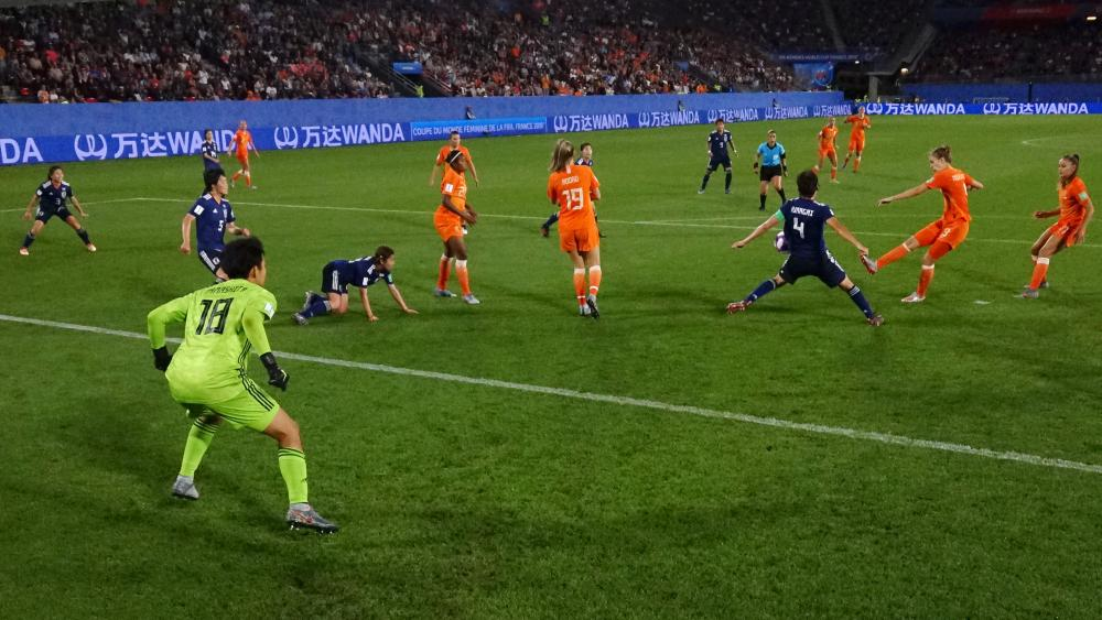 Saki Kumagai of Japan commits hand ball as Vivianne Miedema of the Netherlands shoots, leading to Netherlands being awarded a penalty