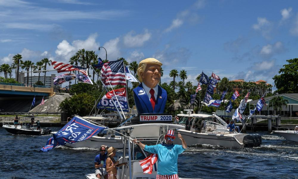 Supporters of US President Donald Trump wave flags as they participates in a boat rally to celebrate Donald Trump's birthday in Fort Lauderdale, Florida.