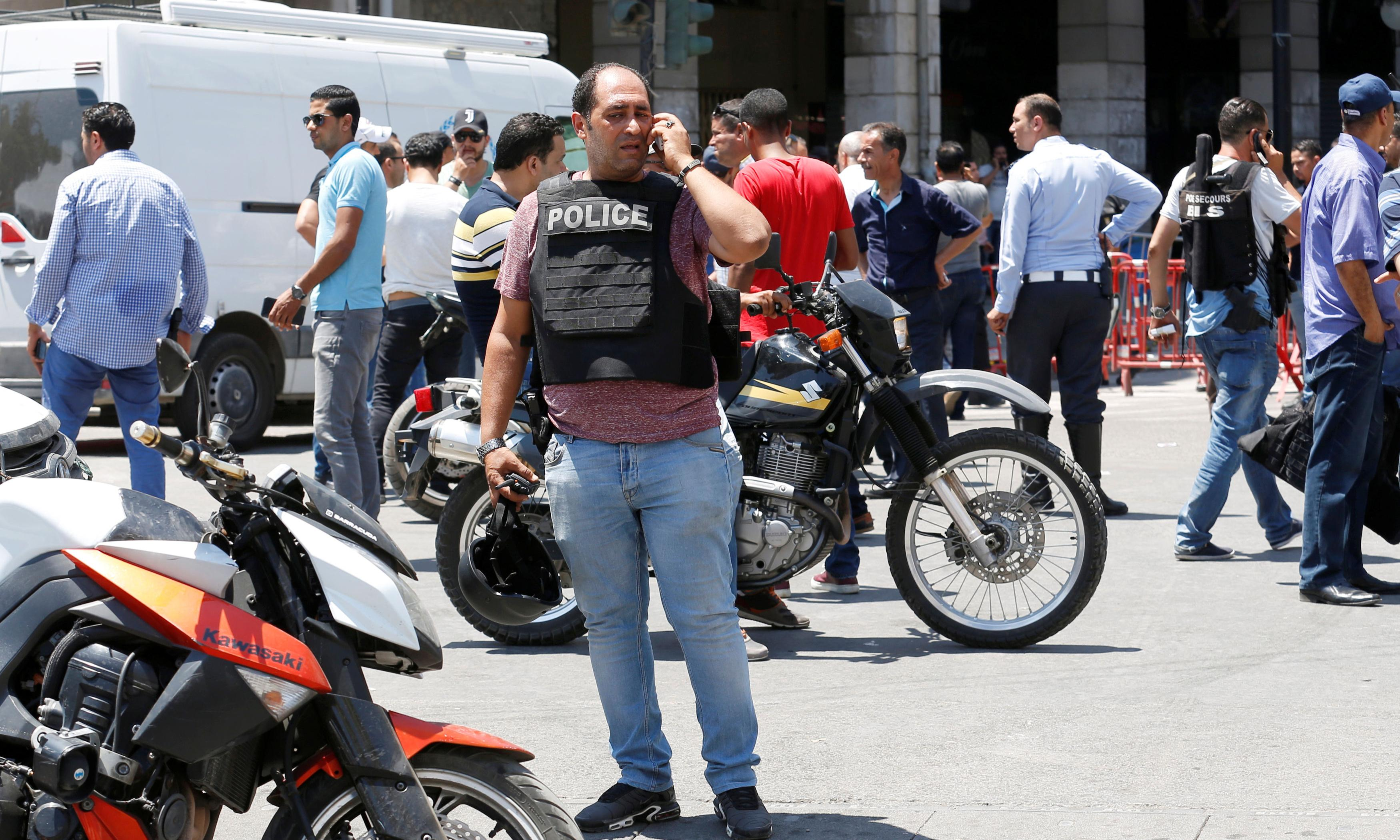 Suicide bombers kill police officer in attacks in Tunis