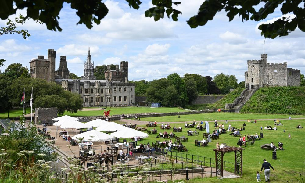 People social distancing in the grounds of Cardiff Castle which is attracting over 2000 visitors a day. Coronavirus lockdown measures continue to be eased as circulation of the coronavirus falls in Wales.