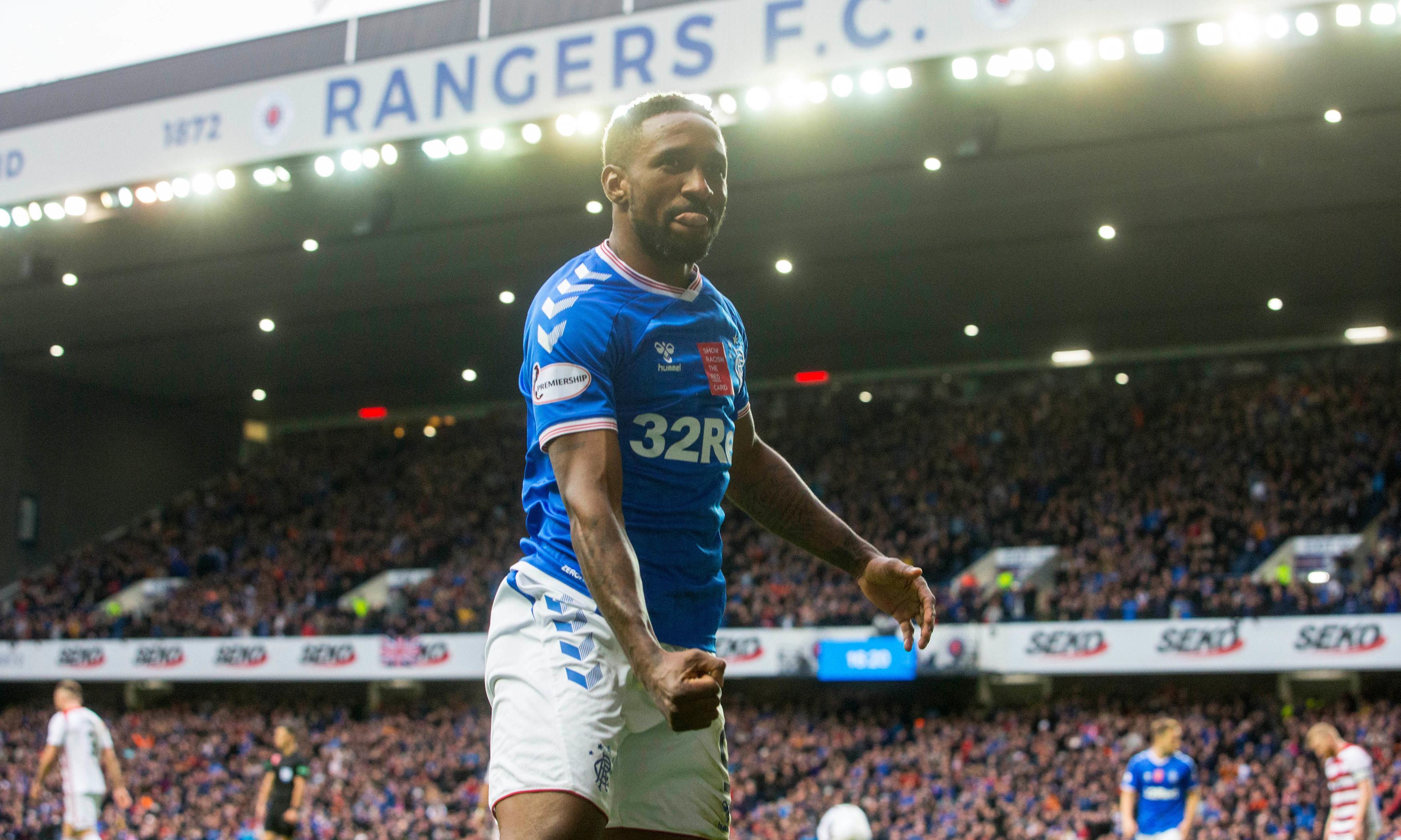 Jermain Defoe hat-trick puts Rangers top after 10-man Celtic lose