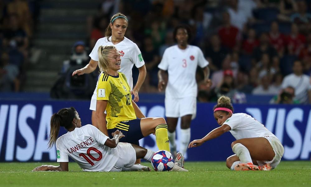Sweden's Fridolina Rolfo is fouled by Ashley Lawrence.