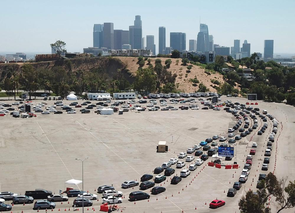 """Cars on July 15, 2020, at a Covid-19 testing site at Dodgers Stadium in Los Angeles, California. Los Angeles County Public health director Barbara Ferrer said that """"We are in an alarming and dangerous phase"""" of the coronavirus pandemic and access to testing in hard-hit communities would be dramatically expanded."""