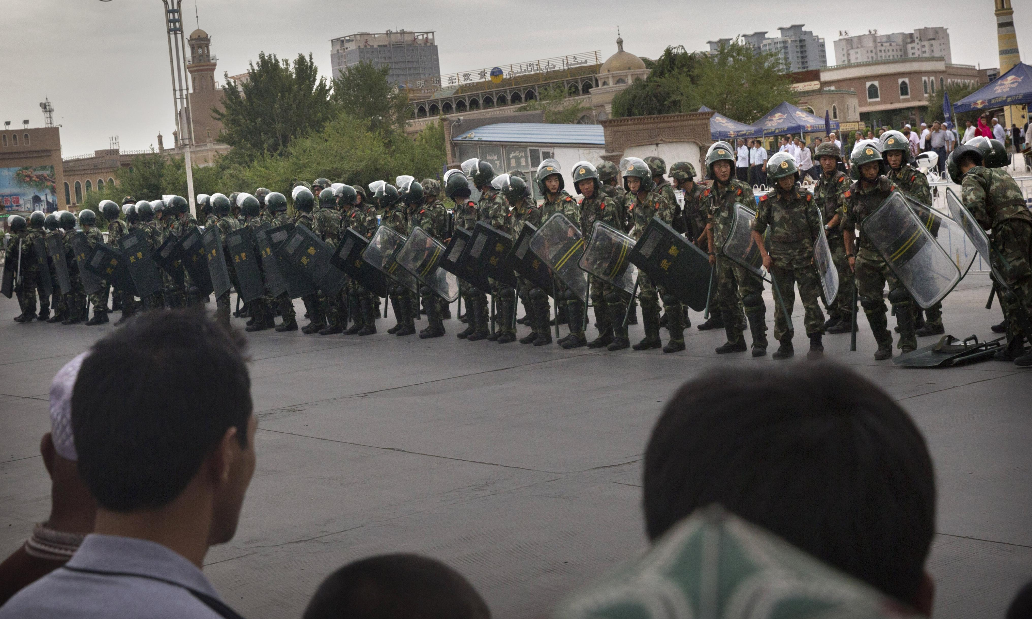 The Guardian view on Xinjiang, China: forced labour and fashion shows